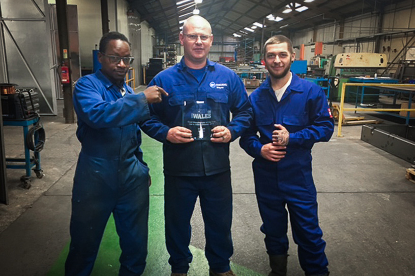 Amcanu workers holding the Made in Wales award