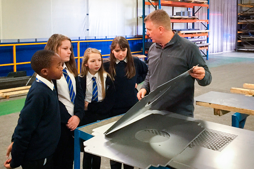 Owain helping educate pupils from Glan-y-Môr School in the workshop