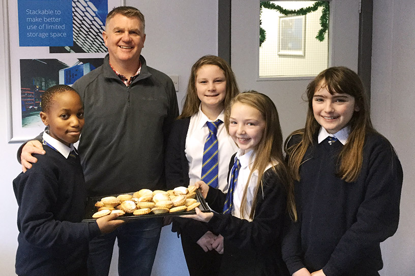 Laura, Bradley, Josi and Emily from Glan-y-mor school give a tray of mince pies to Owain Davies.