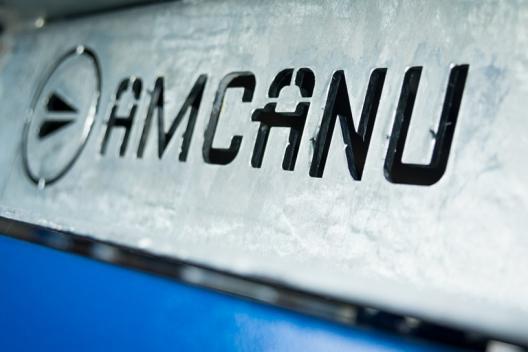 Amcanu logo cut out of metal