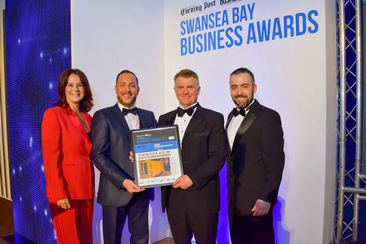Owain being presented award at Swansea Bay Business awards