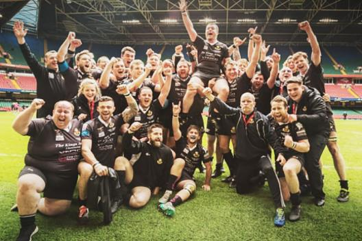 Group shot of Burry Port RFC group celebrating their Swalec Bowl Championship victory