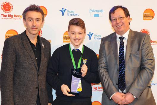 Charlie receiving his award