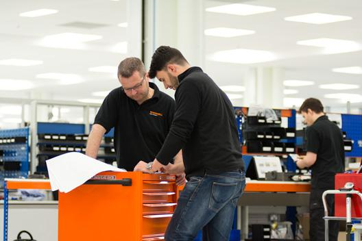 Renishaw engineers on production line